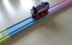 Pastel colored Brio wooden train tracks. woodpeckers.ch #decoartprojects