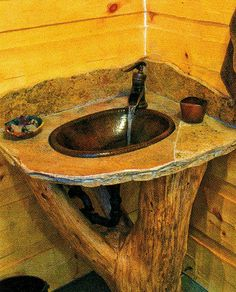 A homemade log pedestal sink created by a reader in Log Home Living magazine.now- Beautiful - if i ever het to build my own house.