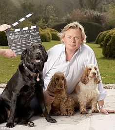 Martin Clunes with his dogs Arthur Colin, Mary Elizabeth, and Tina Audrey.