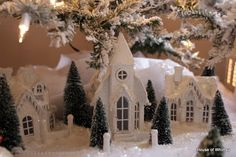 so pretty! We always had a Christmas village scene like this. It has lights inside to light up the windows.