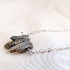 Quartz crystal necklace Beautiful handmade Hematite toned quartz crystal gemstone necklace. 30 inches long. Without clasp, put on over head. The crystals range from a little over 0.5 inches to 1.25 inches in length. Handmade Jewelry Necklaces