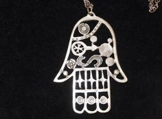 Check out this item in my Etsy shop https://www.etsy.com/listing/173033441/long-chain-hamsa-hand-necklace-antique