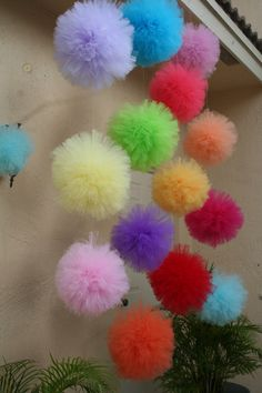 Tulle pom poms. Set of 18. Choose color, size and quantities. $126.00, via Etsy. Backdrop for photo booth