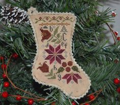 Model stitched over two threads on 32 Ct. Pearled Barley by Lakeside Linens using Weeks Dye Embroidered Christmas Stockings, Cross Stitch Christmas Stockings, Christmas Stocking Pattern, Christmas Embroidery Patterns, Christmas Cross, Stocking Ornaments, Christmas Ornaments, Stocking Ideas, Christmas Decor