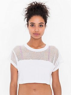 This cropped t-shirt features a light, open knit mesh upper and sporty fit.
