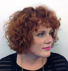 red curly bob with bangs