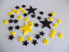 Black yellow stars at allsugarheart on Etsy https://www.etsy.com/listing/251701781/fondant-stars-edible-cake-cupcake-topper