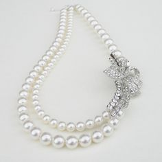 Monique - Bridal Swarovski Crystal Pearl and Rhinestone Bow Necklace.
