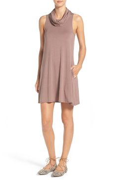 The search for the perfect casual dress that transitions from season to season stops here! In love with this stretch-knit shift dress featuring a flattering cowl neckline that comes in a variety of different colors.