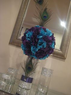 Peacock centerpieces.. Interesting.. Has one more in the vase