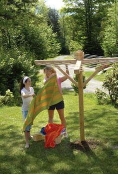 """Michelle Baker and helper with a """"Garden Party"""" clothesline Diy Clothesline Outdoor, Outdoor Clothes Lines, Outdoor Projects, Diy Projects, What A Nice Day, Outdoor Living, Outdoor Decor, Outdoor Outfit, Garden Inspiration"""
