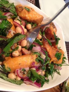Sweet potato, chickpea, red onion warm salad.  Tossed with lemon juice, mint and parsley. Yummy!