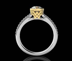 modern design engagement Ring Inspired by the superhero --------------------------------------------------------------------------- Materials: - sterling silver / solid gold - premium cut swarovski cubic zirconia, available colors: white, red, pink, black, blue