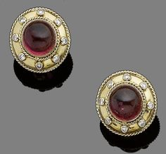 A pair of tourmaline and diamond earclips, by Theo Fennell, 1990 Each circular cabochon pink tourmaline within an 18 carat gold border highlighted with brilliant-cut diamonds, diamonds approx. 0.45ct total, signed Fennell, London hallmark, diameter 2.2cm