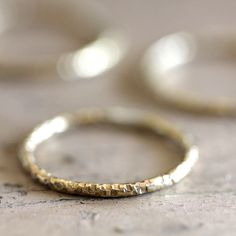 14 karat gold textured ring. This thin unique textured ring is a perfect wedding ring or great stacked with other rings. This listing is for ONE ring. A set of 3 rings are available here in this listi