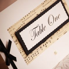Vintage Music Table Names...freestanding and created from vintage music sheets with pearl heart and satin ribbon embellishment