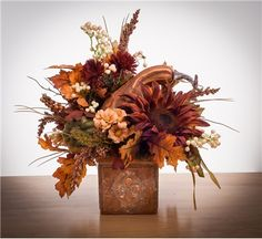 Overall Size: 12 in wide in tall Container size: 4 in sq Fall mix of sunflowers, berries, oak leaves, gourds and pumpkins beautifully arranged in weathe Fall Deco Mesh, Fall Floral Arrangements, Autumn Decorating, Fall Home Decor, Fall Flowers, Fall Wreaths, Fall Harvest, Fall Crafts, Halloween