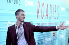 """Machine Gun Kelly Photos Photos - Rapper Machine Gun Kelly attends the premiere for Showtime's """"Roadies"""" at The Theatre at Ace Hotel on June 6, 2016 in Los Angeles, California. - Premiere For Showtime's 'Roadies' - Red Carpet"""