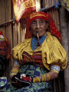 Google Image Result for http://imgc.allpostersimages.com/images/P-473-488-90/27/2728/SZKND00Z/posters/cindy-miller-hopkins-old-woman-with-pipe-in-hand-stitched-molas-kuna-indian-san-blas-islands-panama.jpg