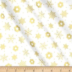 Designed by Liz Goodrick-Dillon for Quilting Treasures, this festive cotton print fabric is perfect for quilting, apparel and home decor accents. Colors include white with gold metallic snowflakes.