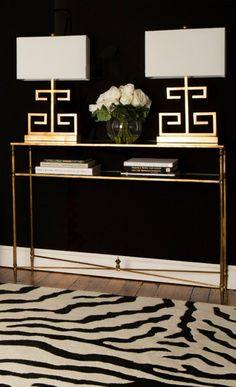 Gold, Black and White Foyer Elegance Elegant foyer with dramatic elements: Zebra print rug, gold table and lamps and black walls! Design Entrée, House Design, Design Trends, Lobby Design, Design Model, Foyer Decorating, Interior Decorating, Decorating Ideas, Decorating Bookshelves
