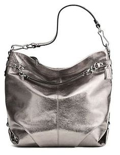 http://peakmomentum.org/?qpn-pinnable-post=coach-leather-large-brooke-convertible-hobo-bag-purse-16618-pewter-silver Leather with silver hardware.