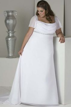 This simple wedding gown has sheer flutter #sleeves to cover the top portion of the arm. The open neckline features the bust. There is an empire waist line in this design to help flatter the curvy bride. We can produce custom #plussizeweddingdresses like this for you at a great price.We can also offer #replicas of couture #gowns for brides who love a dress that is out of their budget. Get pricing on any picture at www.dariuscordell.com