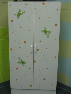 I love the bouncing frogs and polka dots on this white cabinet great way to easily dress it up