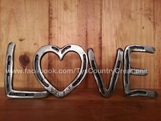 Horseshoe home decor LOVE sign from Country Creations. Perfect for a western wedding!