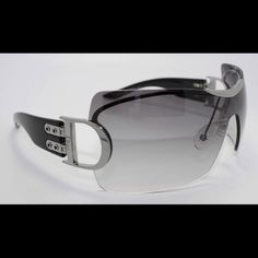 Christian Dior Airspeed 1 sunglasses with case AUTHENTIC ! No scratches or marks. Wonderful condition. CD Airspeed 1 sunglasses worn by Madonna, Halle Berry, Eva Longoria among many other celebs. Comes with case, cards, and lens cloth (which is the only thing that shows wear due to cleaning them after every wear) two toned gray ombre that fades from dark to light gray as pictured. Silver hardware and black temples. SIZE: LENS 76MM, BRIDGE 14MM,  TEMPLE 105MM Christian Dior Accessories…