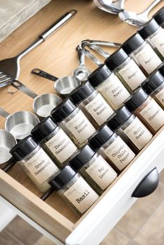 Dollar Store Spice Organization and Printable Labels - use tension rods to raise the spice jars at an angle. Spice Drawer, Spice Storage, Spice Organization, Diy Kitchen Storage, Diy Storage, Storage Ideas, Storage Systems, Jewelry Storage, Diy Kitchen Projects