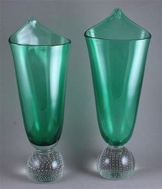 $180  Sept. 2014.  14 bids  PAIR-ERICKSON-GLASS-JACK-IN-THE-PULPIT-VASES-EMERALD-GREEN-BODYS-WITH-CRYSTA