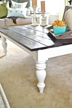 So pretty!  This table used to be black!  She took the top off completely, painted the base and legs and then put stained wood on the top.  I want this!