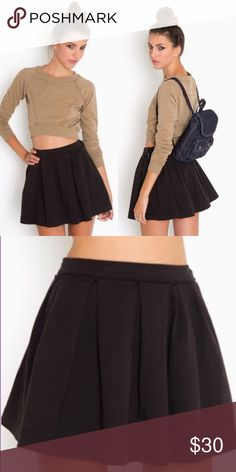 Pleated Varsity Skirt Black pleated varsity skirt from Nasty Gal☺️! This high waisted skirt is great for dressing up or down this summer, you can even pop some tights on and have it be a winter staple also! This skirt is a size small and has no stretch Nasty Gal Skirts Circle & Skater