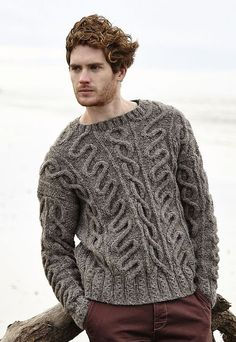 A fall or winter sweater. Thick most likely made of wool or a combination of.....