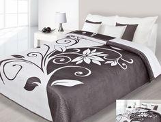 Białe narzuty dwustronne na łóżko z brązowymi wzorami