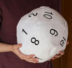 Roll large with a jumbo plush D20! Who knew 20-sided dice could be so much fun? A pefect addition to casual game nights or your next gathering. Pass one around -- no one can resist squeezing or huggin