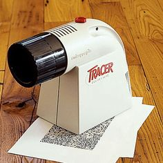 This is how the Artograph Tracer Projector works. You place it on top of whatever you want to trace or paint and then start working your magic!!
