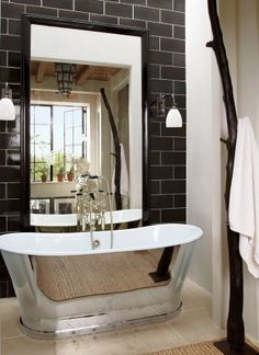 Rustic Bathroom by Alfredo Paredes and Michael Neumann Architecture in New York, New York