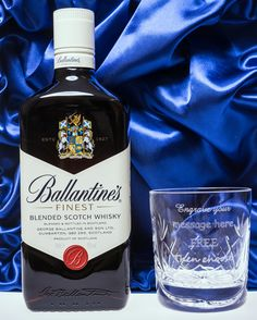 ENGRAVED CRYSTAL GLASS AND 70CL BOTTLE OF BALLANTINES WHISKY