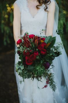 Wedding bouquet with roses, peppercorns and protea