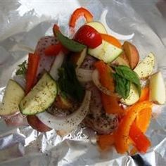 """Grilled Chicken and Potato Foil Packs   """"Moist, flavorful chicken with potatoes, onions, bell peppers, and mushrooms cooked on the grill in foil packs, makes clean-up a breeze!"""""""