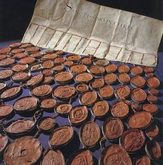 """A refusal of annulment would require recourse to extreme measures for the good of the kingdom which we would not hesitate to take"" -- 1530 letter from English noblemen 'asking' the pope to annul the Henry VIII/Catherine of Aragon marriage. 81 wax seals on red silk ribbons, attached to a 3-ft-wide parchment. From the Vatican Secret Archives, on display in 2012 for the first time."