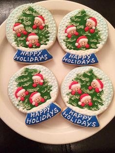 Snow globe cookies with tree and elves.