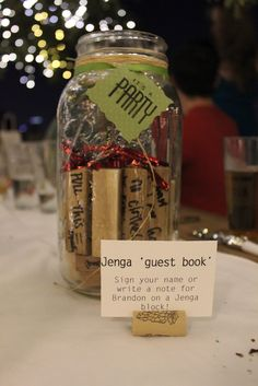 jenga block guest book, what a great grad party idea... I love it! Then I would have a set to play with with all my friends' and families' names :D