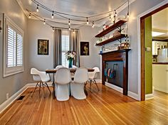 Mid Century Modern Dining Room Decor In A Turn Of The Century Home. String  Of Lights ...