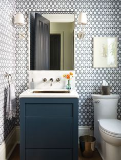 Handsome Powder Room Geometric wallpaper by David Hicks adds bold pattern to this main-floor powder room. Designer Sara Bellamy brought in a tailored navy vanity and simpler fixtures to balance the effect and keep the room from looking too busy. Wallpaper For Small Bathrooms, Bathroom Wallpaper Navy, Powder Room Wallpaper, Bathroom Small, Modern Bathroom, Home Design, Design Ideas, Layout Design, Design Projects