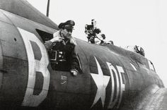 """Major William Wyler (1902-1981) on board the B-17 """"Bad Penny"""" of the 8th Air Force's 91st Bomb Group. It was from such a vantage point and perspective that part of his famous documentary """"The Memphis Belle"""" was filmed. Note the second camera mounted behind the top machine gun turret."""