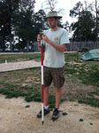 Senior Staff Archeologist Danny Schmidt holding Stadia Rod