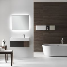 A bathroom environment sized according to your needs. QUATTRO.ZERO furniture unit with drawer and door in matt Mink lacquer and Natural Walnut finishings, with washbasin in Ceramilux SSL with 25 cm side shelf and tapware on side shelf. Discover more on www.falper.it